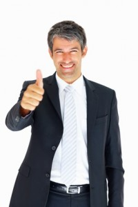 Handsome senior business man with thumbs up on an isolated white background